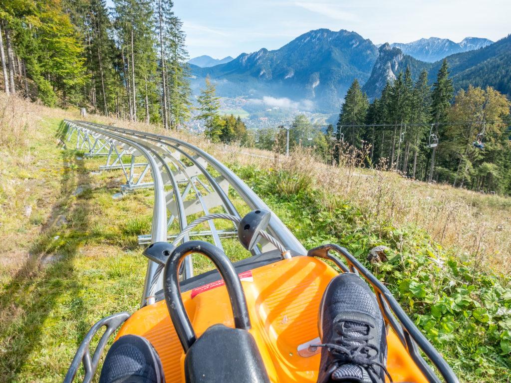 OBERAMMERGAU - OCTOBER 13 : Alpine coaster in Kolbensattel mountain, slide down with gravity, no engine, in Oberammergau, Germany, on October 13, 2016.
